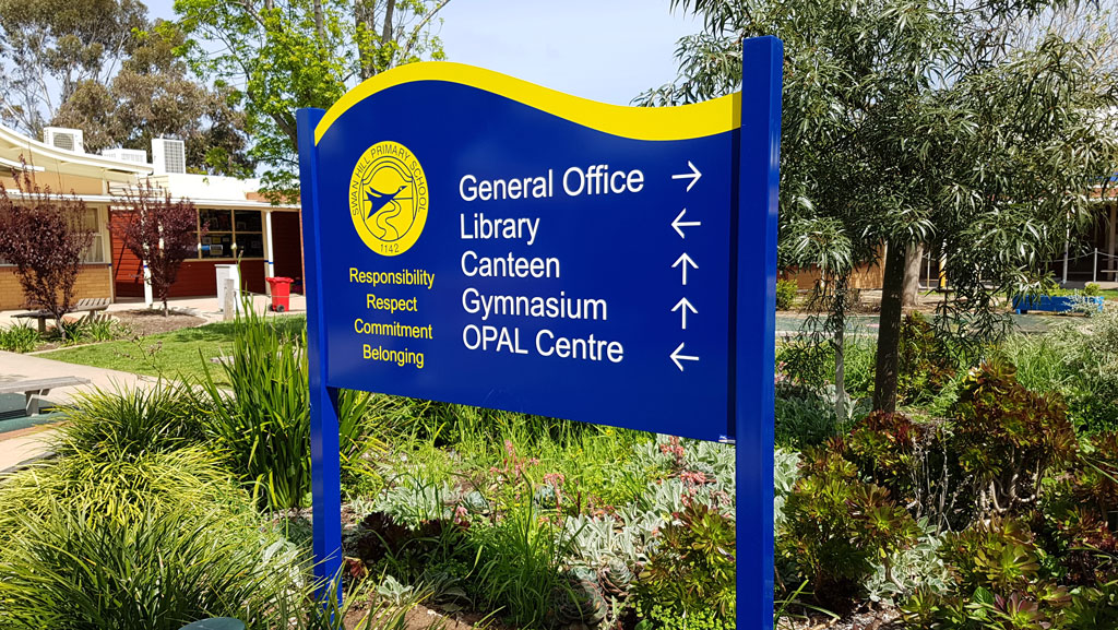 Custom manufactured welcome sign for a school. Blue and yellow colour scheme with white lettering, made in Australia.