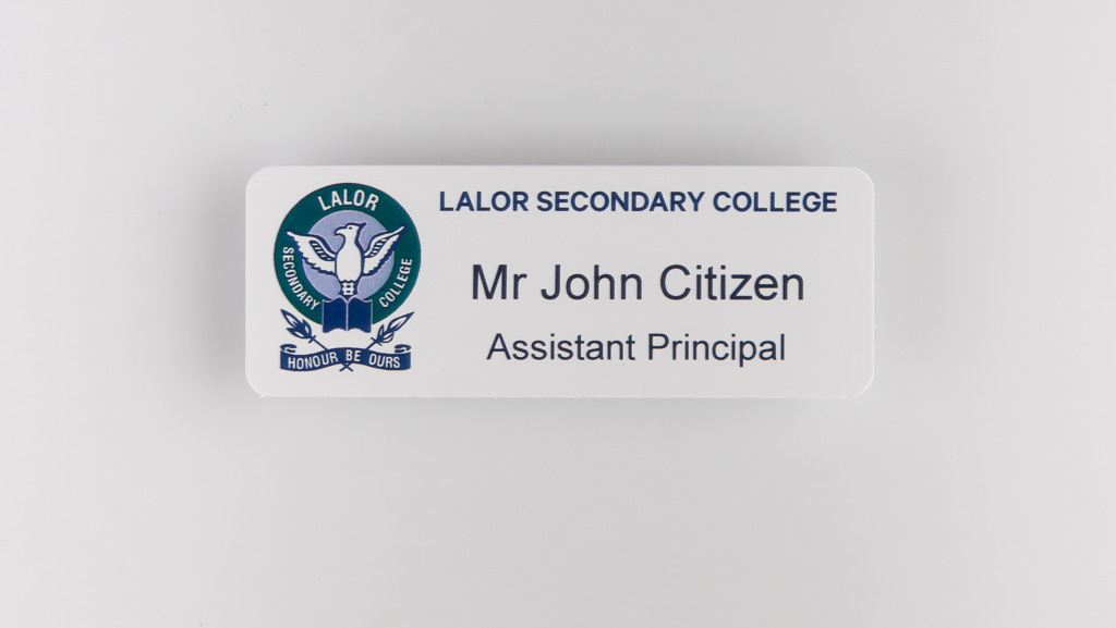 Flat silver name badge school principal