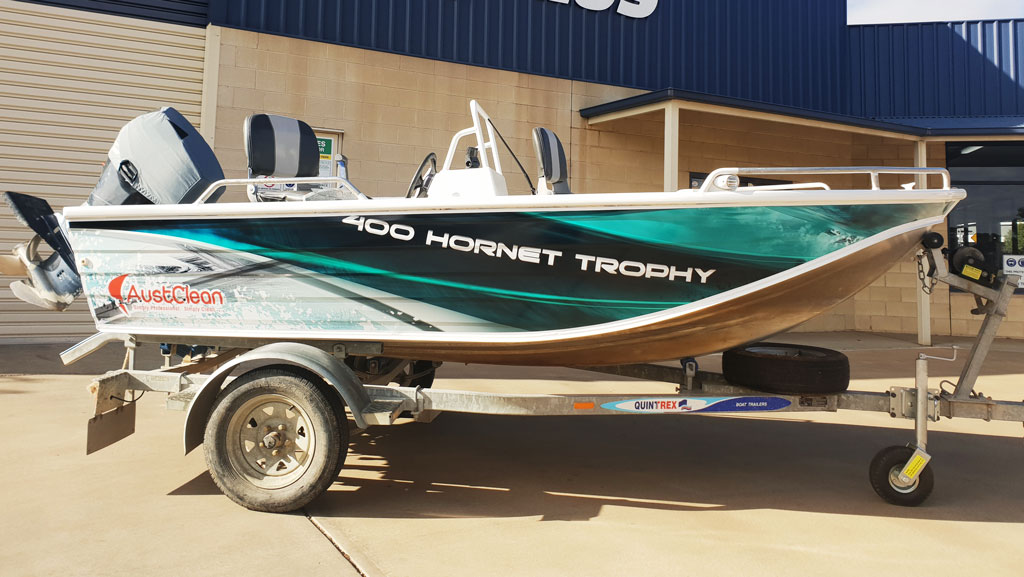 Custom designed and printed graphics on a tinny boat.