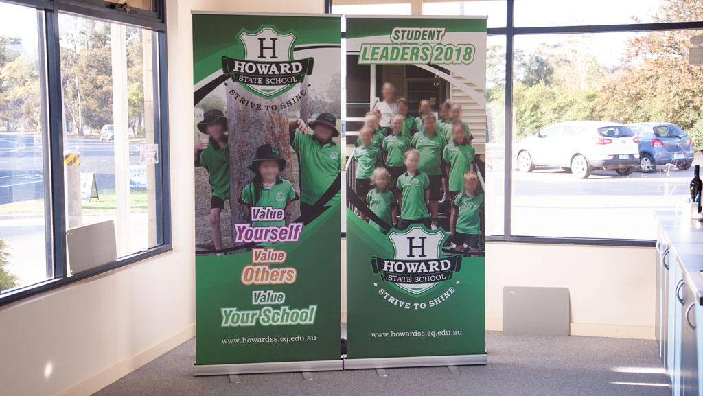 Two custom standard sized retractable banner for schools.