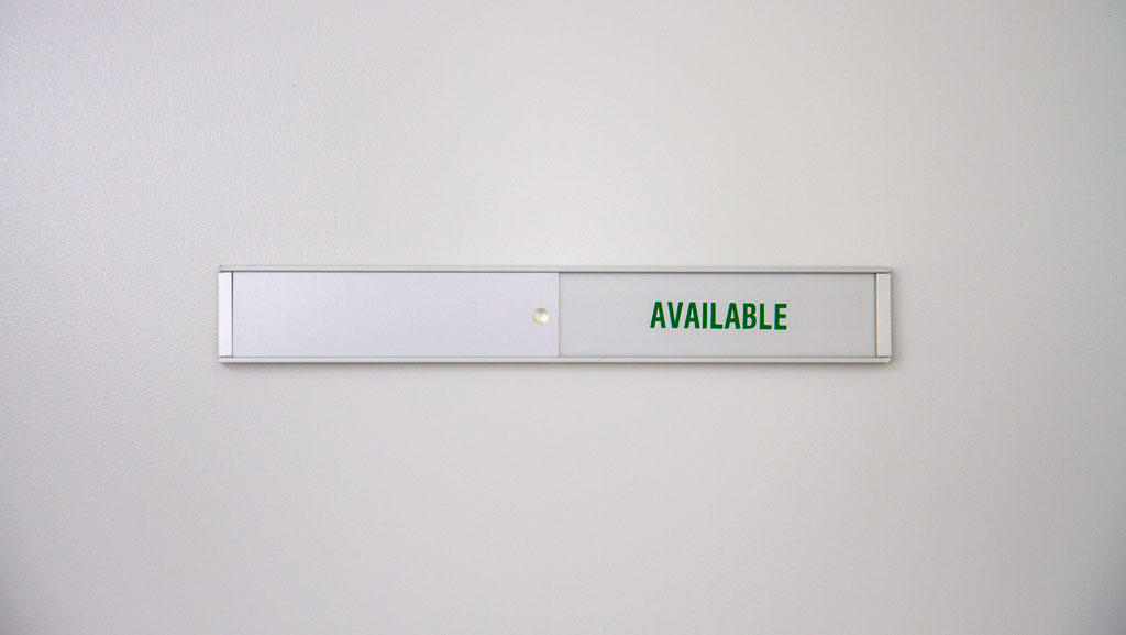 "An interchangeable door soon, currently showing ""Available"" that can be changed when need for your office meeting room."