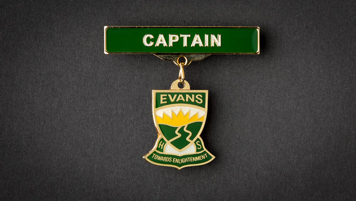 One custom made metal school captain badge.