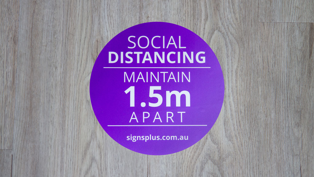 Social distancing floor graphic.