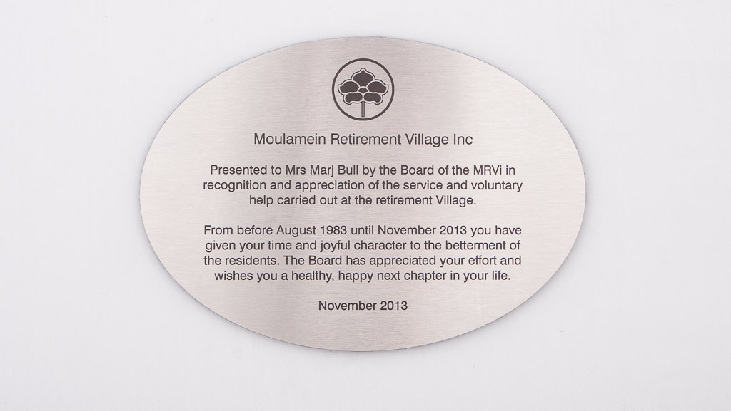 A custom manufactured laser engraved plaque that is oval in shape for a retirement village.