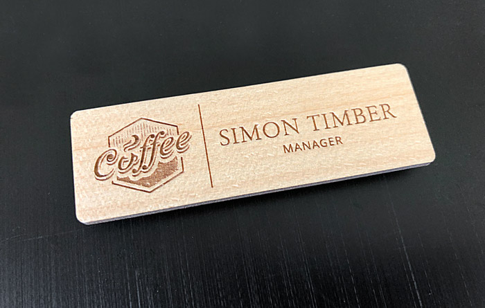 "A wooden name badge for a fictitious hipster cafe with the rather ironic name of ""Simon Timber"""