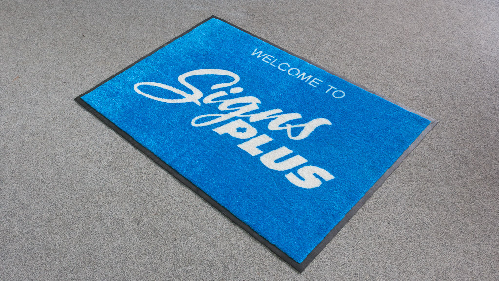 A custom blue welcome mat.