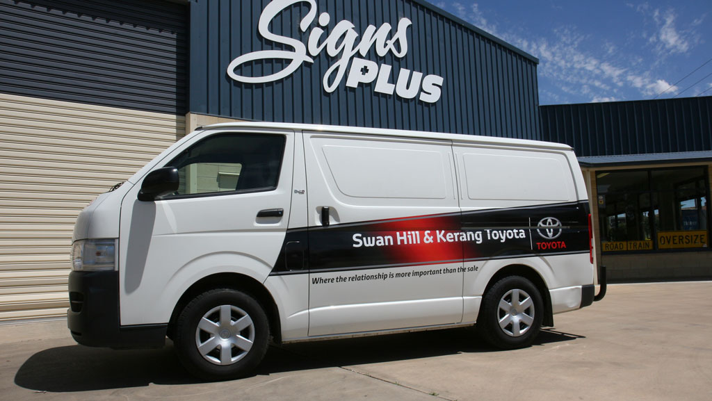 Vehicle graphics on a Toyota Hi Ace vehicle.