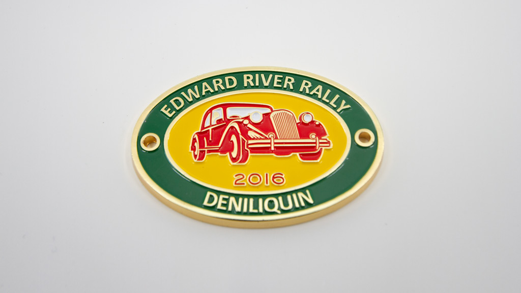 Gold, green, red and yellow car badge, designed in Australia.