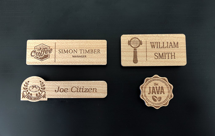 Four different wooden name badge designs