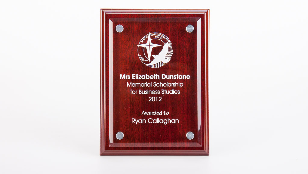 Custom scholarship award plaque. Wooden plaque with laser engraved glass panel