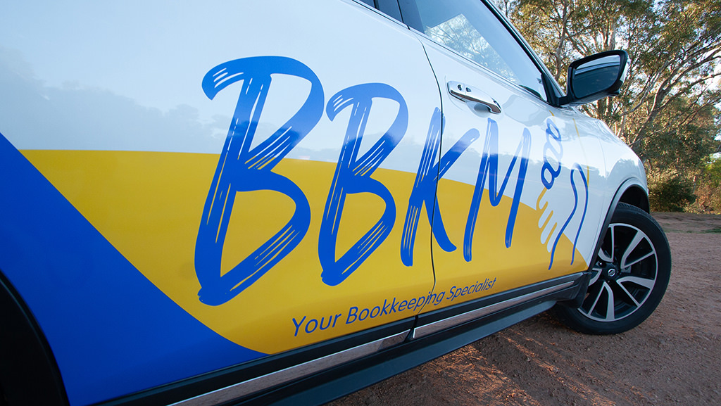 accounting firm vehicle wrap signage