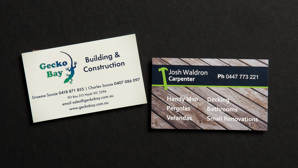 Two building and construction company business cards.