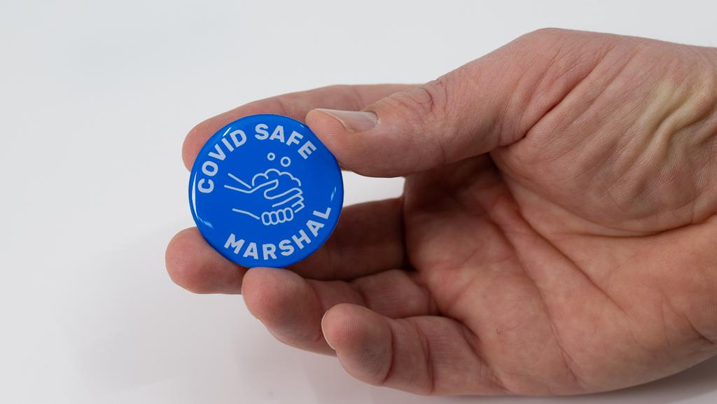 Holding Covid-19 Safe Social Distance Blue Marshal Coronavirus Pandemic Custom Badge 40mm