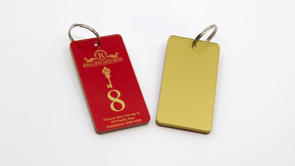 Custom key tags, red front and a gold back.