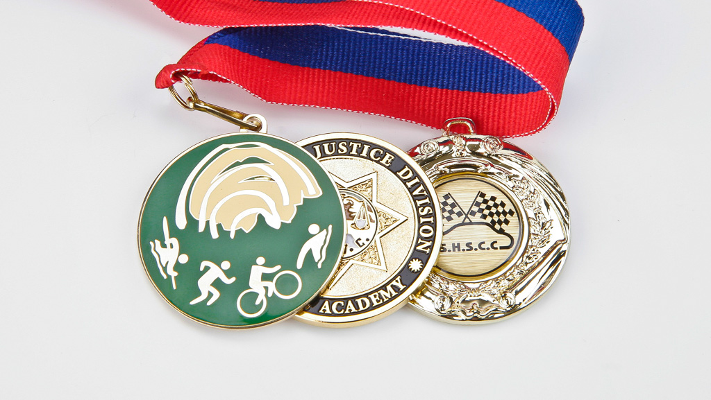 3 custom made medals and medallions.