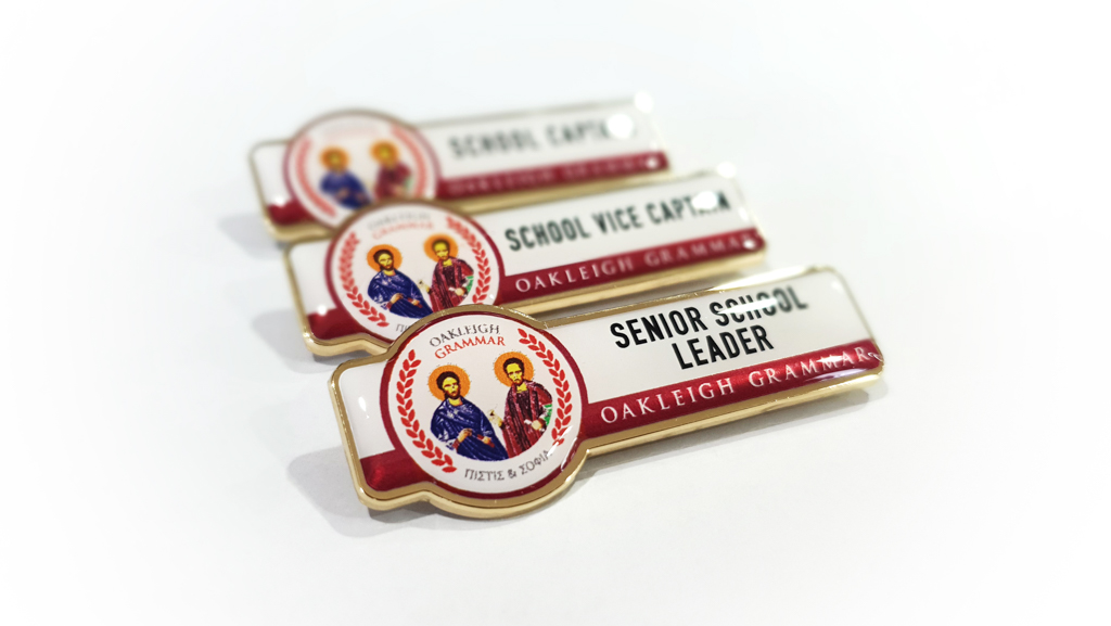 Custom made metal student and staff badges for schools.