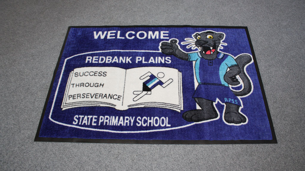 Welcome logo mat with custom text and logo.