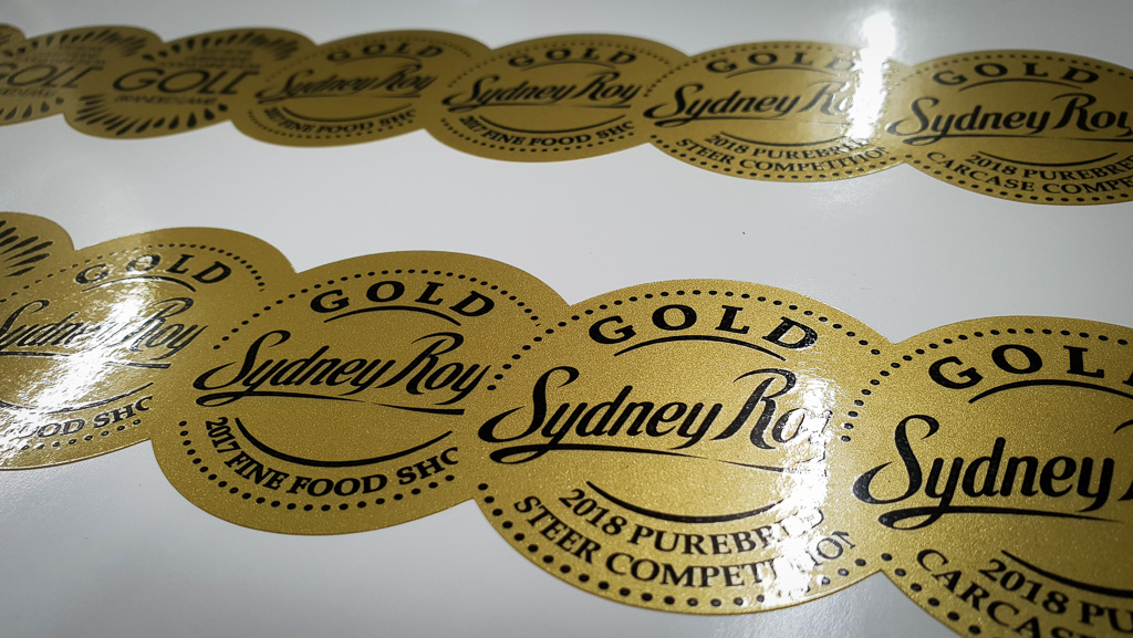 Amazing stickers, black lettering on a real looking gold backing, that shines and reflects.