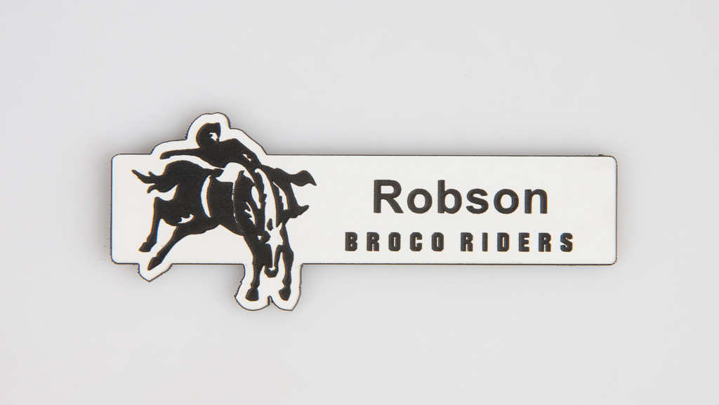 Custom shaped silver name badge engraved