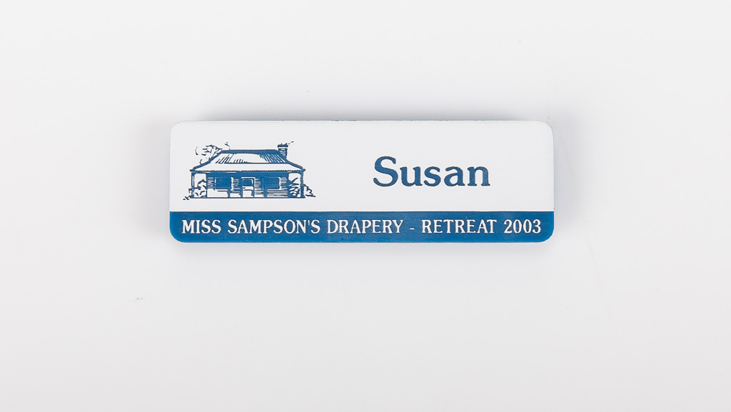 white and blue personalised name tag