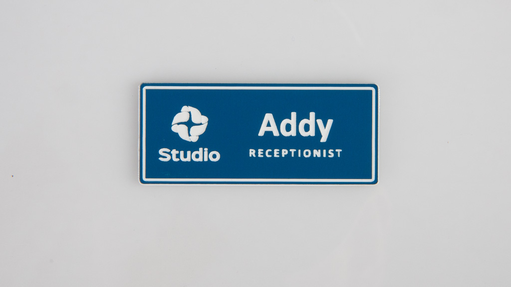 rectangle engraved white and blue name badge