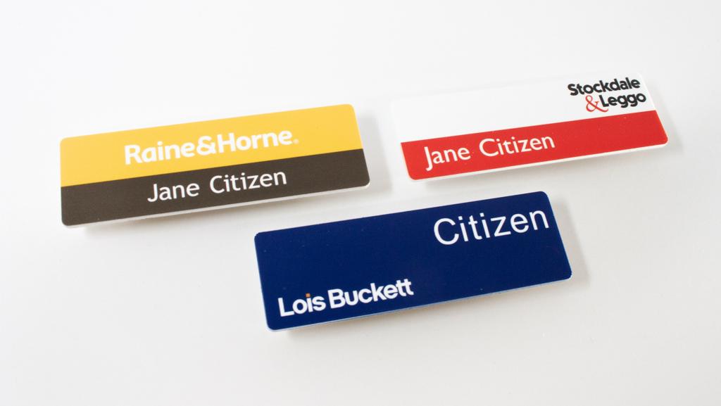 Personalised flat name badges.