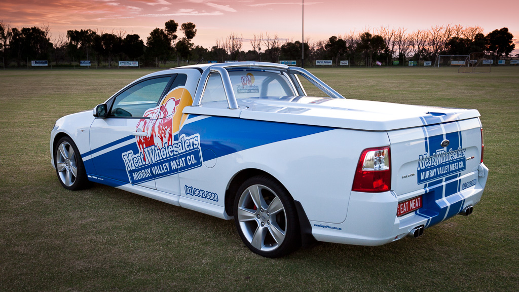 Aussie utel with custom vinyl graphics in a racing theme.
