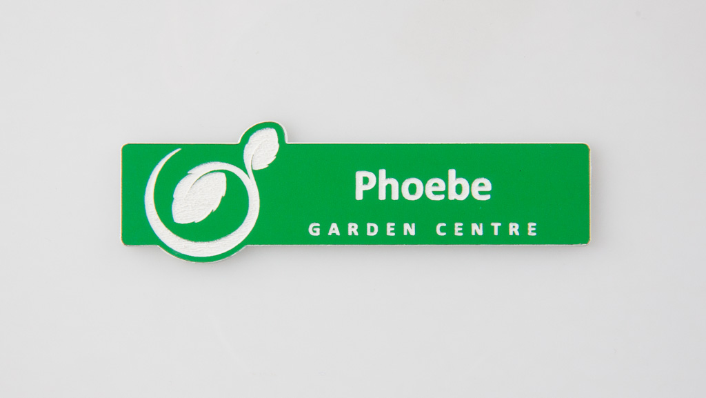 A green personalised name tag