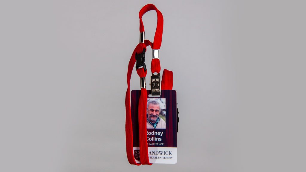 ID card with a red lanyard.