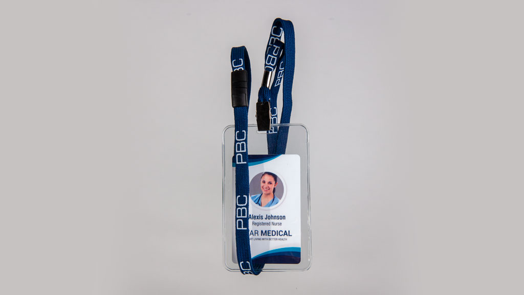 A blue lanyard with a nurse ID card.