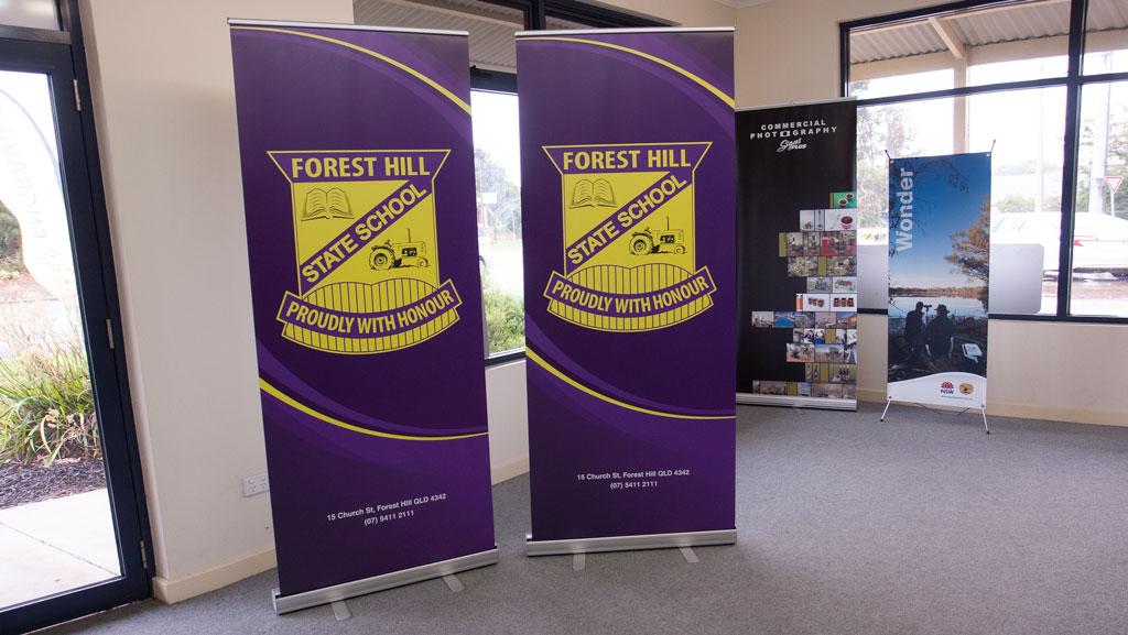 Two custom school pull up banner in purple.