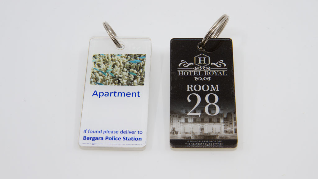 Custom plastic motel key tag with keyring.