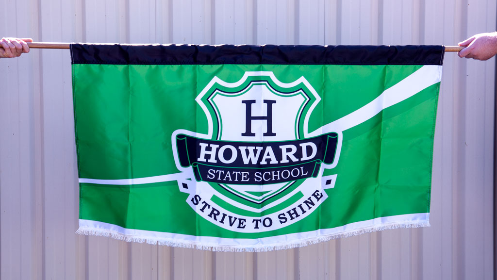 Custom made marching banner with a white fringe on the bottom. Possibly, with the best school logo you have ever seen.